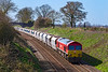 25th Mar 2019:  Approaching Great Cheverell with eighteen hoppers in tow is 59203.  It had starteted from Whatley Quarry and is going to West Drayton