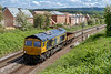 21st May 2019:  66736 'Bluebell Railway' heading 6V44 to Biscester from Marchwood is captured as nears Trowbridge.  This 'as and when' service can have a good load, empty flats or as in this case just one emty box.  At least it is in the sun.