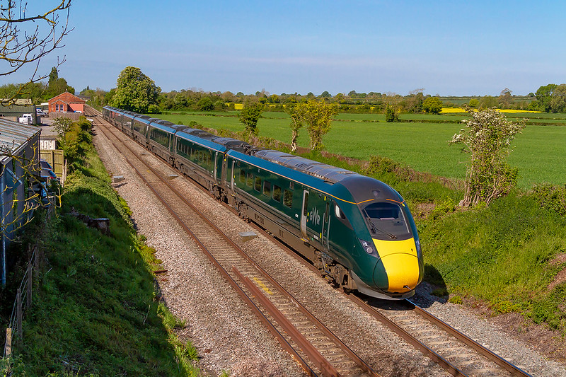 12th Mayn 2019:  What ever the light this colour scheme is crap! 800309 is passing through the site of Edington & Bratton station that closed in 1954.  1A77 is the 08.30 from Exeter to Paddington