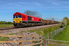 14th May 2019:  7V16 is the returning empties from Fareham ARC sidings to Whatley Quarry,  Starting at 12.03 7 minutes late now after reversal at Westbury 66113 is now 7 minutes early as it crosses Masters Crossing near Fairwood.