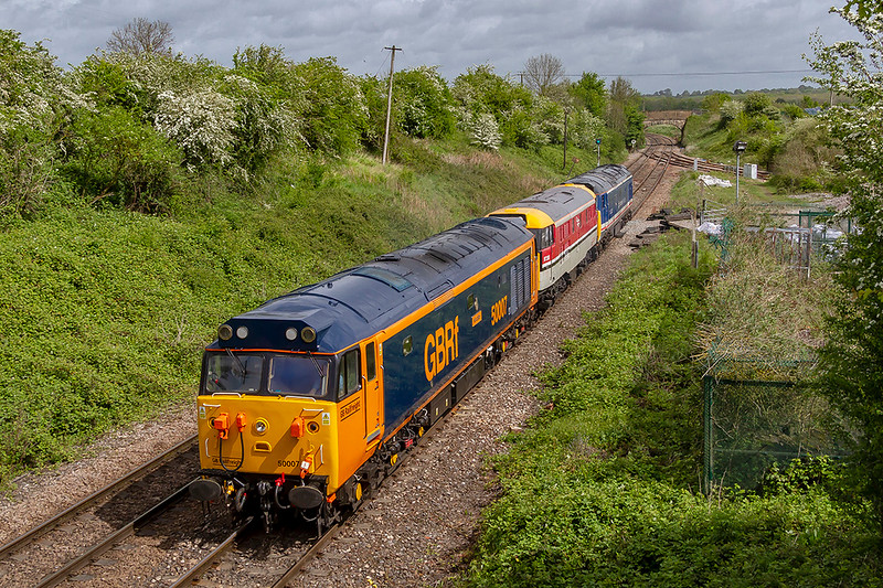 8th May 2019:  Crawling up to the signal at Hawkeridge is 0Z50 from Kidderminster to Swanage.  50007 'Hercules' is proviiding the urge to take the two other locos to Swanage  for the Gala.  In the Derby RTC paint scheme is 97205 this started life as D5581 but became 31163 and in Network Southeast Scheme is 50026 'Indomitable'.