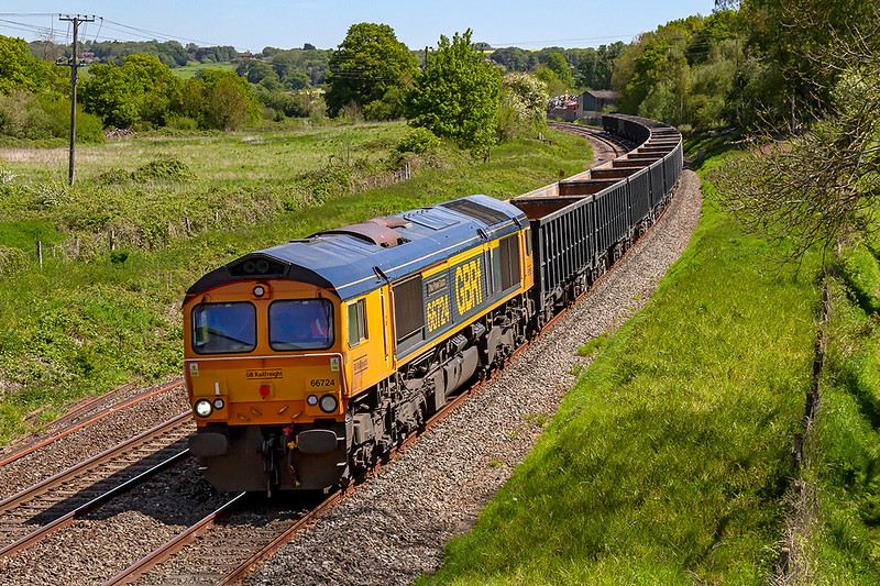14th May 2019:  66724 'Drax Power Station' is again allocated to work 6C42 from Wellingborough to Whatley Quarry.  Today it is picturedas it runs through Great Cheverell.