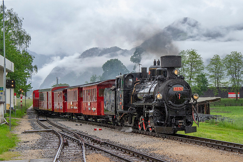 29th May 2019:   Running for for 21 miles the 760mm guage Zillertalbahn from Jenbach to Mayrhofen has an half hourly passenger service using DMUs and Deisel haules coaches.  For tourists there is also a steam hauled service that is seen here arriving, in light rain, at the intermediate station in Fugen.