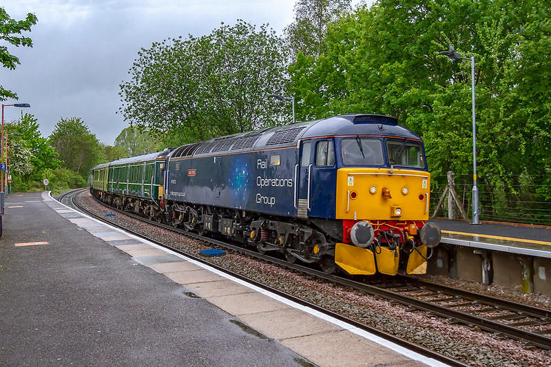 8th May 2019:  ROG loco 47813 'Jack Frost' is leading on 5Q86 that is taking a pair of DMU coaches to Eastleigh from Long Marston.  Pictured at Warminster with 57303 out of sight while acting as tail gunner.
