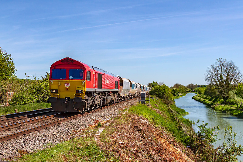 13th May 2109:  59205 is pictured as it is about to cross 'Crofton Crossing' and then pass the Crofton Pumping Station as it works 6C31 from Theale to Whatleyt Quarry.  The Kennett and `Avon canal is on the right.  Recent clearance work has opened up this shot again.