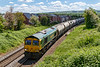 21st May 2019:  When this came into view it  was all in shaddow !!!.  I was not expecting that 6M36 to Tunstead from the Westbury Cement works would be in the hands of a Freightliner loco.  66621 on 6M36 is pictured at Mud Lane in Trowbridge