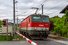 27th May 2019: 1144 057 on a double headed freight heading west has just passed through Oberndorf station to the north of Kitzbuhel