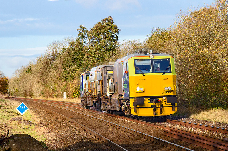 12th Nov 2019: Working the return leg of the RHTT duty from Effingham Junction to Warminster are  DR 98914 and RDR 98964 pictured in the Wylye Valley at the Sherrington Lane crossing.