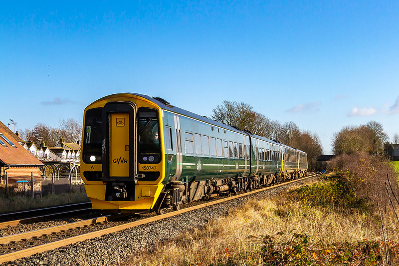 29th Nov 2019:  Now that there are many 165/186 Turbos in the srea GWR have  reverted their 3 car 518s into the original 2 car format..  Running them as pairs  makes a 4 car format giving extra seats.  Here 1F14 the 10.23 to Cardiff from Portsmouth Harbour is passing through Wylye composed of 156747 and 158762