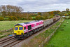 8th Nov 2019:  The one good thing that can be said about the pink 'One' livery is that it stands out well on  a dull day.  Today 66587 is rostered on 6C58, the returning empties from Oxford Banbury Road to Whatley, is captiured as it runs through Gteat Cheverell  is on the Berks & Hants line.