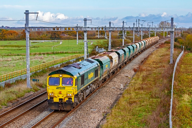 13th Nov 2019:  6B35 is the Freightliner service from Hayes & Harlington to Stoke Gifford.  Powered by 66601 the empties are at South Mardton near Swindon.
