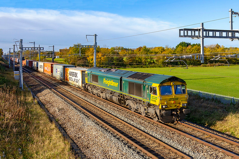 13th Nov 2019:  In lovely morning light 66599 is at South Marston as powers 4L36 to Felixstow from Wentloog