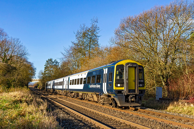29th Nov 2019:  I cannot say that I am impressed by the SWR livery but at least it shows up well in a picture. 159002 is pictured at Wylye as it works 1O40 the10.45 from Yeovil Pen Mill to Waterloo