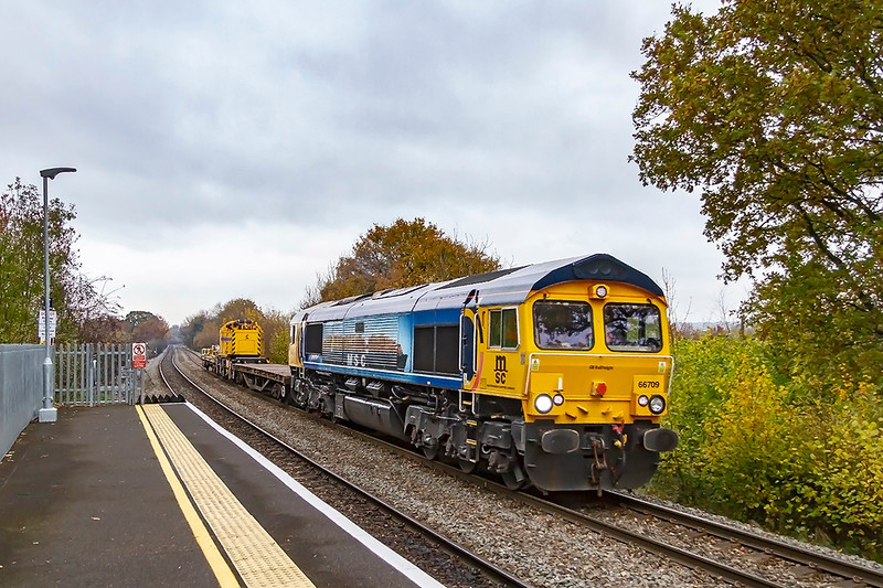 15th Nov 2019:  70809 with  Mediterranean Shipping Company' branding is at Dilton Marsh as it works 6O41 to Eastleigh from Westbury