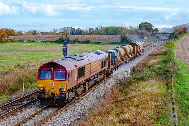 4th Nov 2019:  3J13 the RHTT train from Westbury to St Blazey has been to Salisbury and back and is now at Fairwood as it  heads west.  Leading is 66023 which has recently replaced 66060 which started the seasonns working  while at the rear is still 66068.