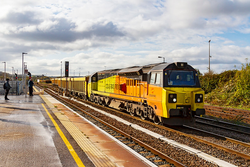 9th Nov 2019:  Snaking it's way out of the Up Yard at Westbury is 70812.  The rake of IOAs is being prepared to leave at 11.55 as 6M40 to Stud farm in Liecestershire to get a ballast refil for the virtual quarry