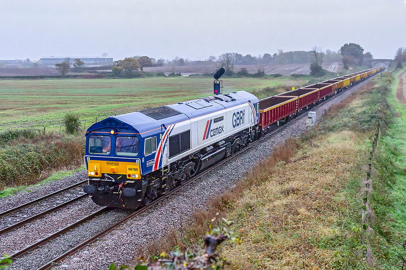 2nd Nov 2019:  Despite the heavy rain and violent winds I made the effort to go to Fairwood to get my first picture of 'The Cemex Express'.  66780 is heading 6G72 that is going to Crediton did require an iso of 3200