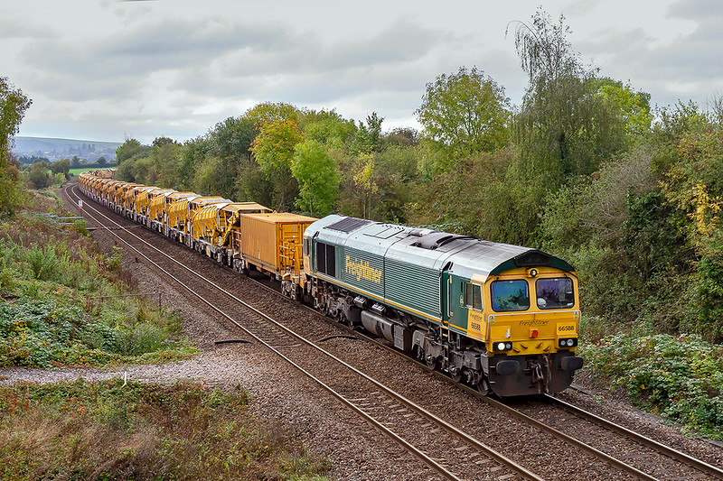 20th Oct 2019:  Powering away from Hawkeridge Junction is 66588 and the HOBC.  6Y15 left Theale Loop 5 minutes late at 10.09 and it had lost a few more at this point.  By the time it arrived at Fairwater Yarnd in  Taunton it was a few minutes early,  Engineering work near Castle Cary being the reason for the diversion via Bristol