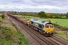 20th Oct 2019:  66543 with a long rake of mainly MHA amd MPA waggons is forming 6Y43 the 08.00 from Castle Cary to Westbury and is nearly there as it runs through Heywood.