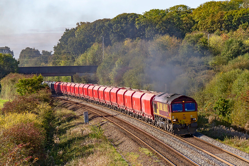 22nd Oct 2019:  66025 is smoking very well as it powers away from Clink Road Junction in Frome as it works 6M20 to St Pancras Churchyard Siding from Whatley Quarry through Berkley.  Not long to go now before this becomes a Freightliner working.