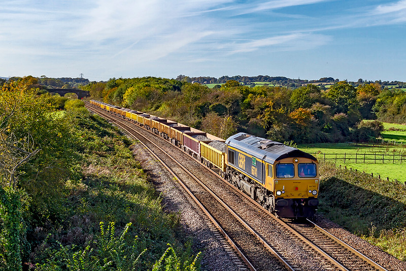 27th Oct 2019:  At 13.37 the first of four GBRf powered departmental services from Crediton to Westbury is at Fairwood .  66741 'Swanage Railway' is providing the urge on 6G82 that started at 10.43