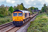18th Oct 2019:  Running down the grade in to Trowbridge is 66761 'Wensledale Railway Association 25 years 1990-2015' on the point od 6B45 from Marchwood to Ludgershall MoD.  Regratably the consist was glider fuel and the sun appeared about a minute after the train passed the foot bridge at Dursley Road.