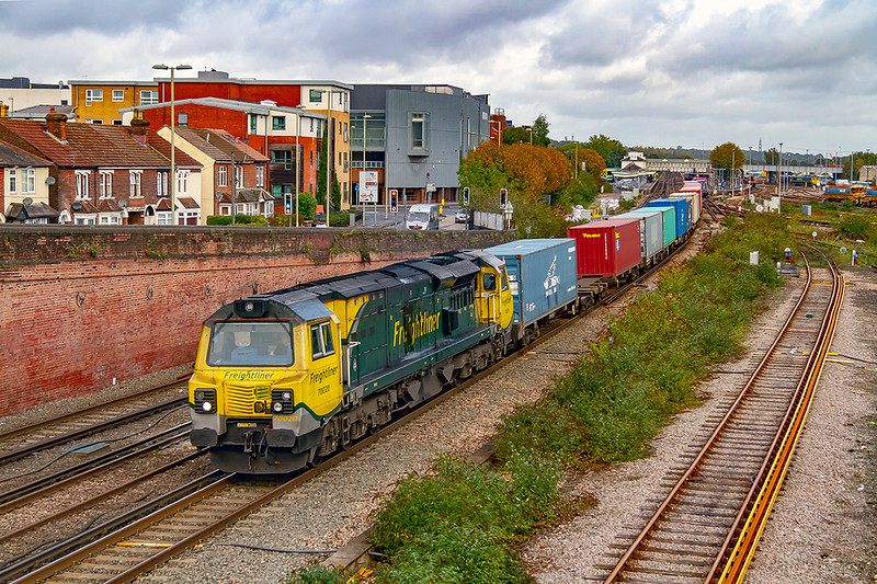 16th Oct 2019:  Powered by a very dirty 70020 the 07.19 from Birch Coppice to Southampton Maritime Container Terminal (4O05) leaves Eastleigh after a crew change in the station.  Note than the line on the right one line has been electrified so that units can be stabled in the sidings that go around the south side of the Arlington yard.