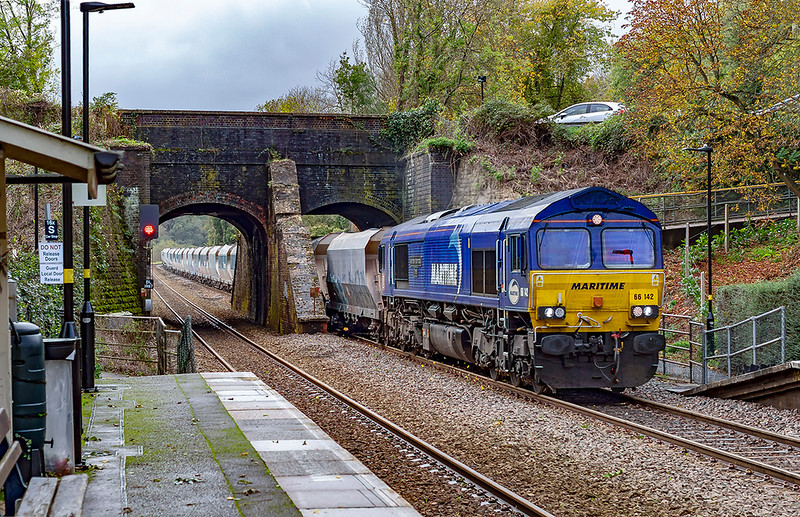 25th Oct 2019:  Passing under the Kennet and Avon Canal at Avoncliff is 'Maritime Intermodal Three', 66142, on the point of 6A83 from Avonmouth Bennets Siding to West Drayton A R C.  This side of the loco is much cleaner than the other side that I pictured yesterday at Faiirwood