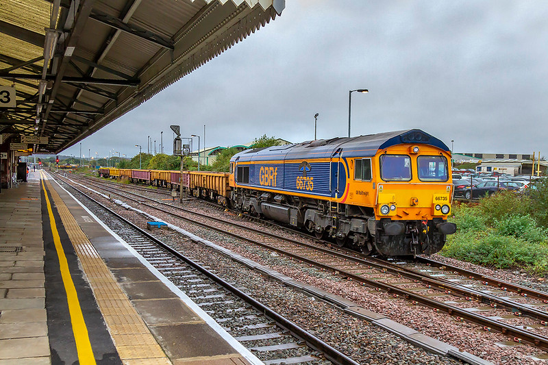 7th Oct 2019;  66735 'Peterborough United' is pushing 6O41 , the afternoon departmental from Eastleigh, back into the recycling  sidings.  Out of sight are a number if flats containing old bull head rail sections on wooden sleepers.