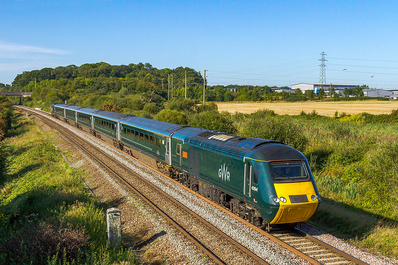 14th ep 2019:  GWR promoted rail tour from Okehampton to Weymouth is pictured at Berkley Marsh near Clink Rod Junction as it heads to Westbury where it will reverse and travel back to Castle Cary where it will take the Weymouth line.  Leading is 43194 that has been named 'Okehampton Castle' and 43199 is on the other end.  The  Castle set with  with the new electric doors is strengthed to be a 5 car set and is the first 'Castle' set in this part of the world.