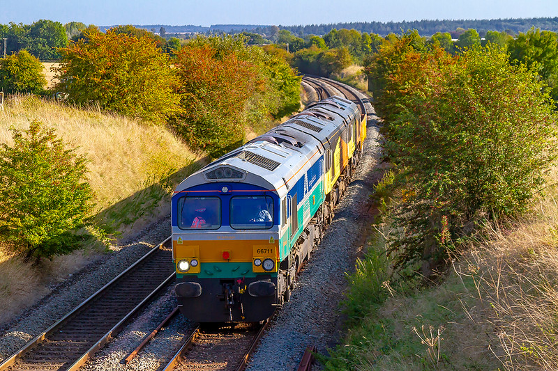 18th Sep 2019:  This is 6V41 departmental from Eastleigh to Westbury powered by 66711 'Sence' at Upton Scudamore.  Had I known that the load was 66850 'David Maidmwnt' and 66849 'Wylam Dilly' and one wagon I would not have been to this spot for the pic !!   C'est la vie.