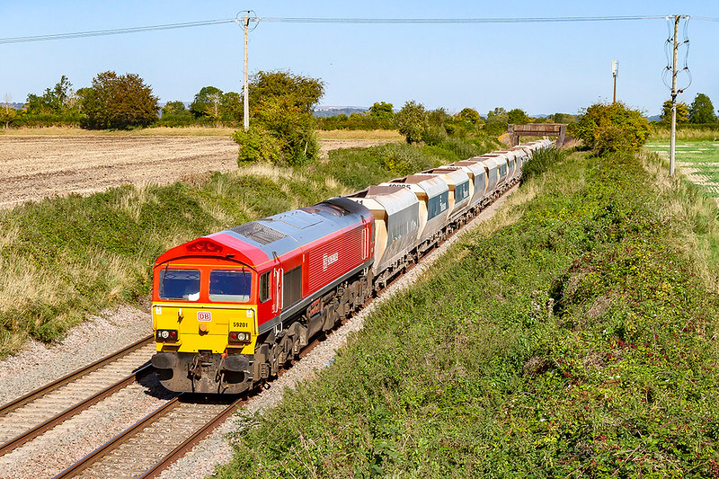 13th Sep 2019_. With the Lambourn Lane bridge in the back ground 59201 is pictured as it runs through Edington as it hauls 6V18 from Allington to Whatley Quarry
