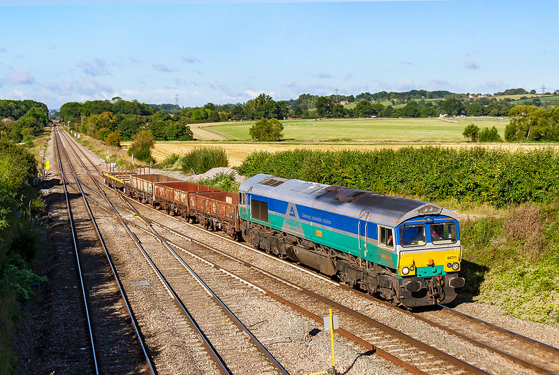 1st Sep 2019:  With three OCAs and a YLA in tow 66711 'Sence' is taking the station line at Fairwood Junction as it works 6G01 from Exmouth Junction to Westbury