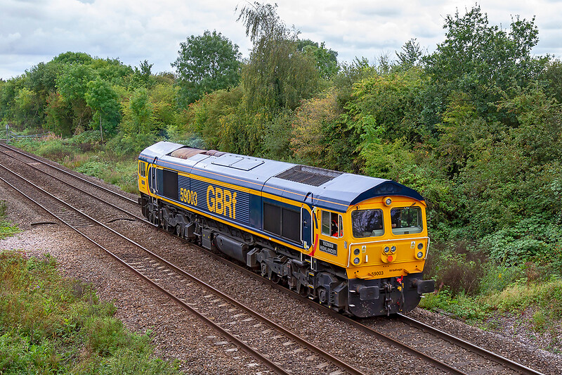 10th Sep 2019:  Having just been hired by Freightliner from GBRf 59003 'Yeoman Highnander' moved from Doncaster to Stoke Gifford yesterday.  Being used  as a driver route learner prior to the take over of the DBC stome workings.  Pictured as it runs away from Hawkeridge Junction after the mornings quarry visits.  A shame about the light though.