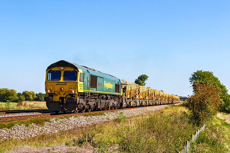 18th Sep 2019:  66533 'Hanjin Express' gets underway from Fairwood Junction with 6C73 that returns the HOBC waggons  to Fairwater Yard in Taunton after they have been refilled at the Westbury Virtual Quarry