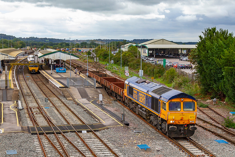 3rd Sep 2019:  The reason that I came to Westbury Station on a rather dismal day was to picure this working.  66753 'EMD Roberts Road' is in charge of 6V44 from Marchwood MOD to Kineton MOD. Although there were four OCAs and a couple of low loaders at the front the rest ofthe train was  empty container flats.