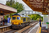 24th Sep 2019:  66705 'Golden Jubilee' has just stopped in Warminster Station for the driver to change ends.  0V40 has come from Eastleigh and will reverse and use the crossover to the other line to gain access to the Warminster MoD depot.