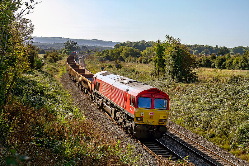 18th Sep 2019:     6W01 is running from Port Talbot to Westbury.  Pictured from Mud Lane in Trowbridge looking towards Westbury 66034 is at the rear and 66021 in on the front