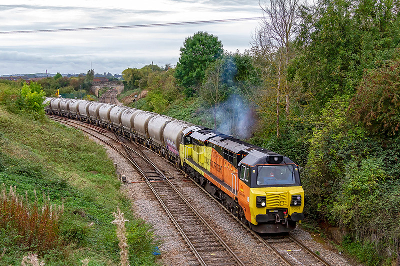 30th Sep 2019:   Bringing 31 PCAs off the East Chord at Hawkeridge Junction is 70808 as it works 6C36 the empty cement tanks back to Aberthaw from the Lafarge storage facility at Westbury