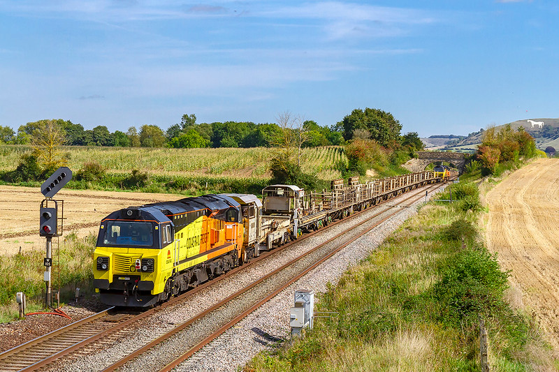 15th Sep 2019:    At Fairwood 70808 is bringing up the rear of 6C97 from Burngullow to Westbury.  On the front using the crossover to gain acceess to the Down Yard is 70812