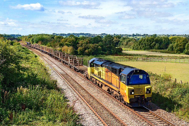 15th Sep 2019: A rather dirty 70812  leads on 6C97 an empty Long Welded Rail train from Burngullow to Westbuey through Fairwood.  70808 is on the other end,
