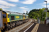 4t Aug 2020:  There was no sun as 4O57 from Wentloog to Southampton Maritime entered tDilton Marsh Halt but a few seconds later as 66558 & 66512 cameinti view it was full sun.  Such is life !