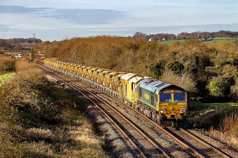 1st Dec 2020:   With the late running 6C72 from Fairwater Yard to Westbury Virtual Quarry in the hands of 66556 it is  pictured from Lamberts Bridge in Fairwood  as it runs from Fairwood Junction to the Station at Westbury.