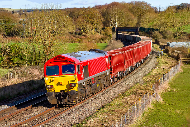 27th Feb 2020: Captured at Great Cheverell is 59204 in charge of 7C77 from Acton to Merehead. The  seven new Tauox wagons are today leading on this working.  I wonder how may more t o be delivered?