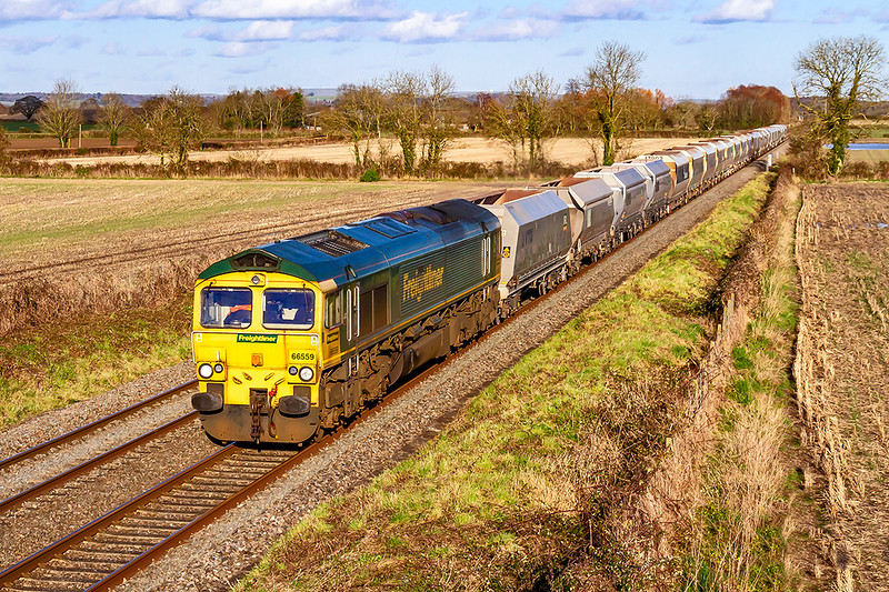 27th Feb 2020:  My first picture of 6V17 fron Allington to Whatley now that it has been taken over by Freightliner.  In the hands of 66559 it is picured from the bridge on Cowleaze Lane in Edington.