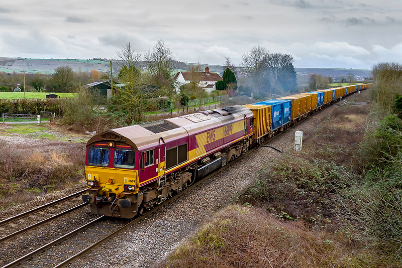 3rd Feb 2020:  Accelerating away from Hawkeridge Junction is 66199.  It is working 6C03 from Northolt Siding with the usual long rake of bins loaded with waste being taken the the  disposal plant in Avonmouth.