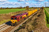 27th Feb 2020:  Approaching the site of Edington & Bratton Station is one of the two pioneer Class 66 locos 66002.  It is working the 'Pong Liner. from Northolt to Severnside `sita