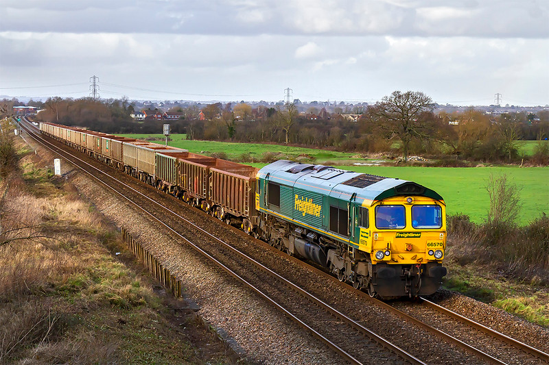 17th Feb 2020:  In a fortunate patch of week sunlight 66570 runs through Heywood as it worksd 6C48 from Appleford to Whatley Quarry.  Tis is my first picture of this working as it is usually much later in the day or dgoes to Stoke Gifford