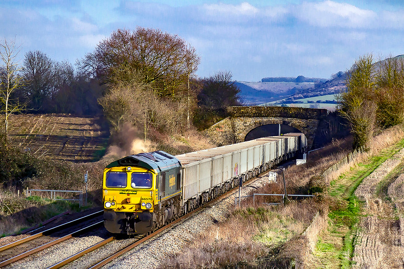 6th Feb 2020:  On a welcome day with plenty of sunny spells 66570 runs between Westbury and Fairwood Junction as it works 6C68 from Avonmouth Hanson Siding to Whatley.
