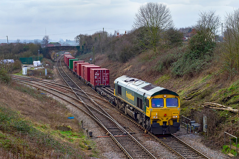 17th jan 2020: Crossing Hawkeridge Junction as it leaves Westbury is 66516 working 4V54 from Southampton Maritime Container Terminal to Avonmouth West Wharf .  Sods Law plays it's part as with a decent consist behind the loco the sun is behind the clouds.   Grrrrr